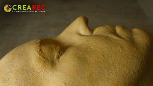 molded gypsum face statue